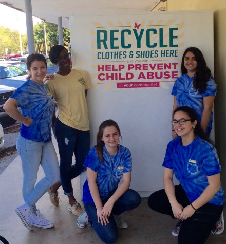 Interact club members worked hard in getting a Lauren's Kids collection bin at Gables.