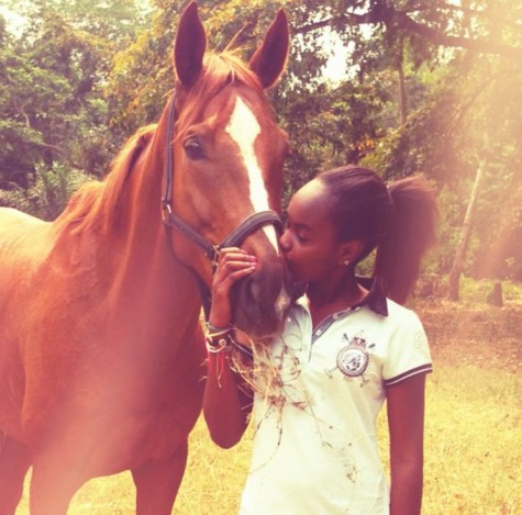 Masungu hanging out with her horse back in Africa