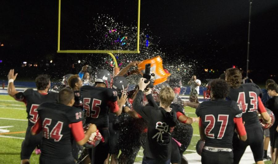 The Cavaliers celebrate after a tough victory against the Columbus Explorers.