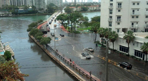 Flooding throughout Miami Beach makes driving difficult.