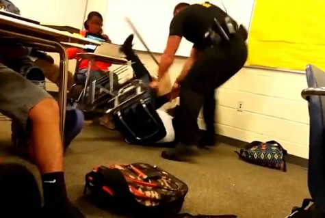 Police Officer Attacks Student in Classroom