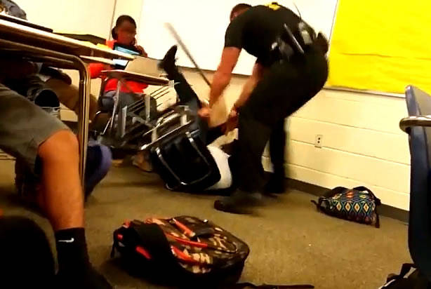 It's hard to believe that an officer would be so aggressive to a student sitting at her desk.