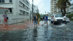 Pedestrians have to walk through shin deep waters to simply cross a street.