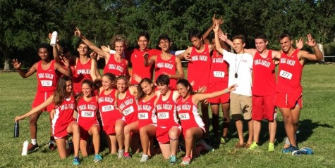 The cross country teams celebrate after both teams got runner-up at Districts.