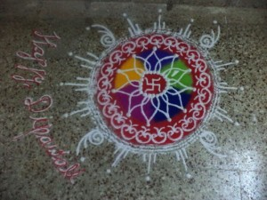 Beautiful flowers are drawn with colorful sand on doorsteps.