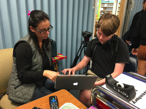 Ms. Camacho helping one of her TV production students