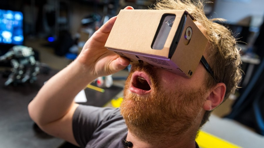A man in awe over his experience with Google Carboard.