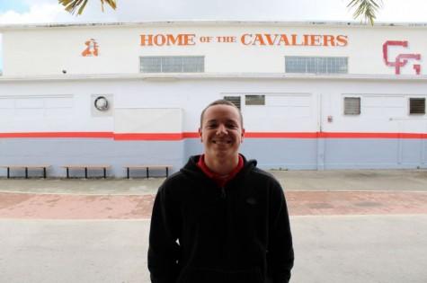 "Junior Eduardo Valdes, Varsity football player says ""cheese"" because of their successful football season."