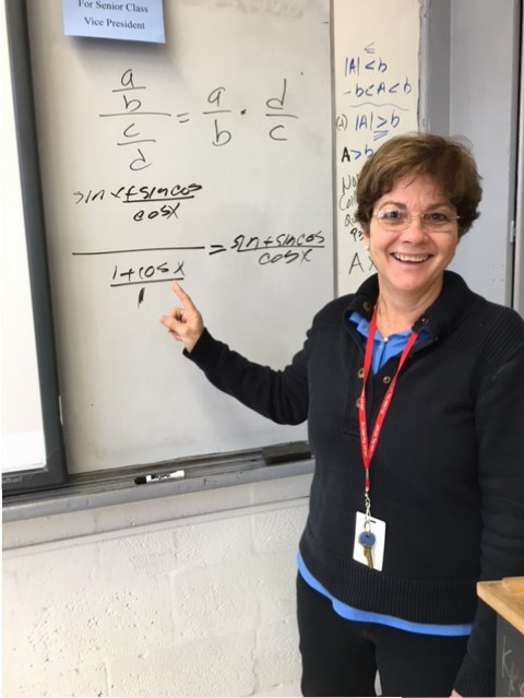 Ms. Prado loves teaching math and explaining problems to her students.