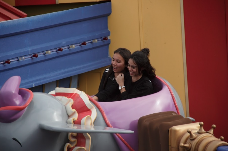 Class of 2019 students laugh as they enjoy the Dumbo the Flying Elephant ride.