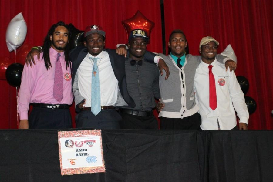 Five Cavalier football players signed with their respective colleges on national signing day.