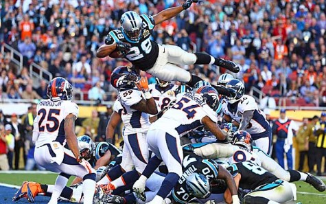 Jonathan Stewart jumps over the pile to score a touchdown and make the score 10-7.