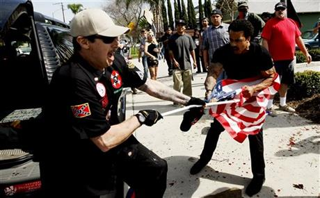 The use of the flag pole as a weapon in seen in this picture from the recent rally the KKK had.