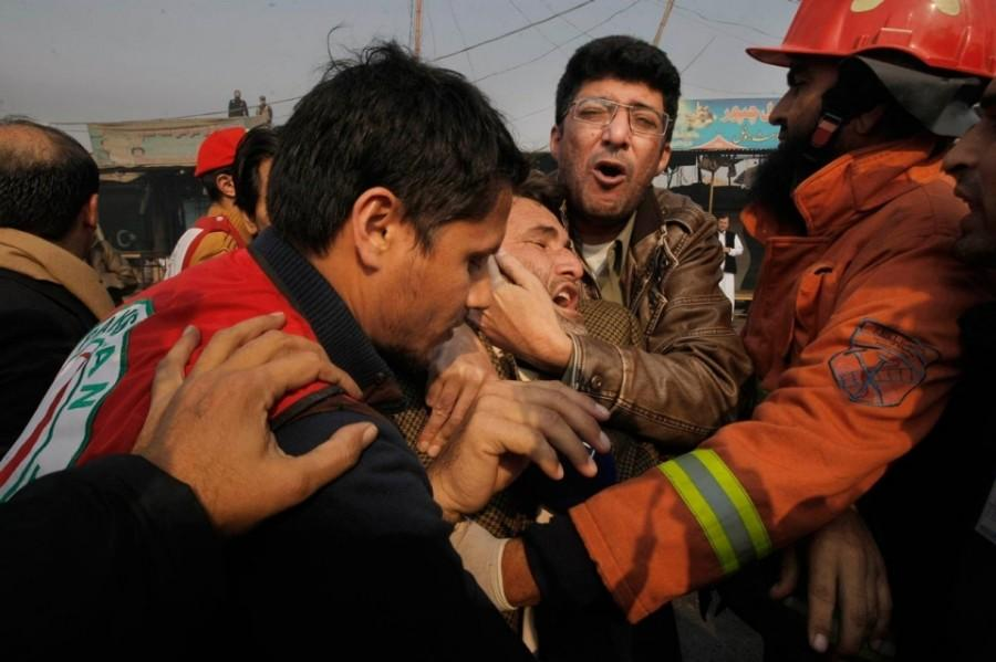 Rescue officials giving aide to the victims of the suicide bombing in an amusement park of Lashore. Pakistan.