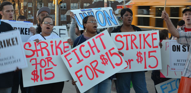 This peaceful protest in Milwaukee, Wisconsin shows fast food workers going on strike for increased wages.