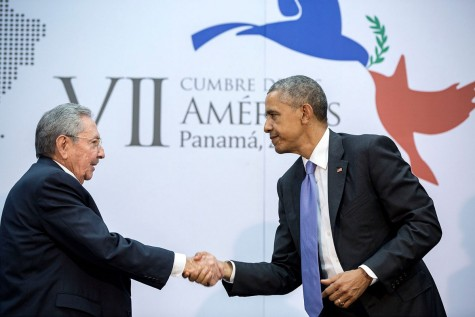 President Obama shakes hands as he speaks with President Castro about making amends