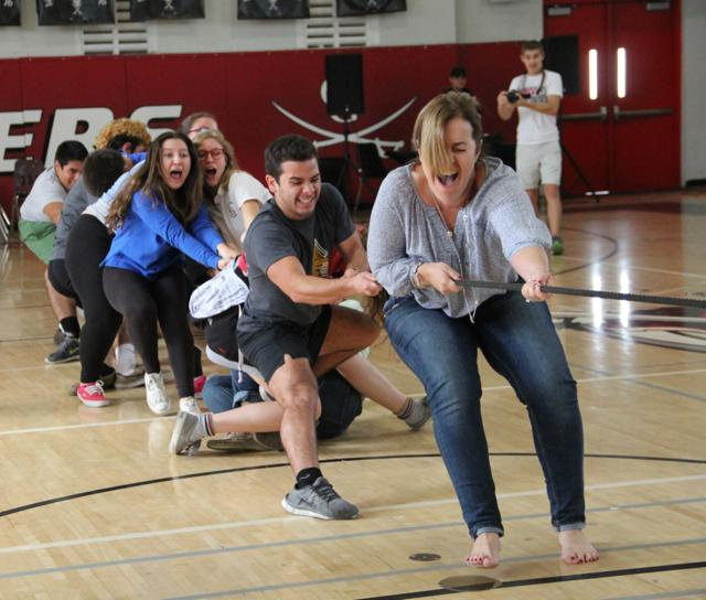 Seniors who signed to out of state colleges enjoyed an intense game of tug of war.