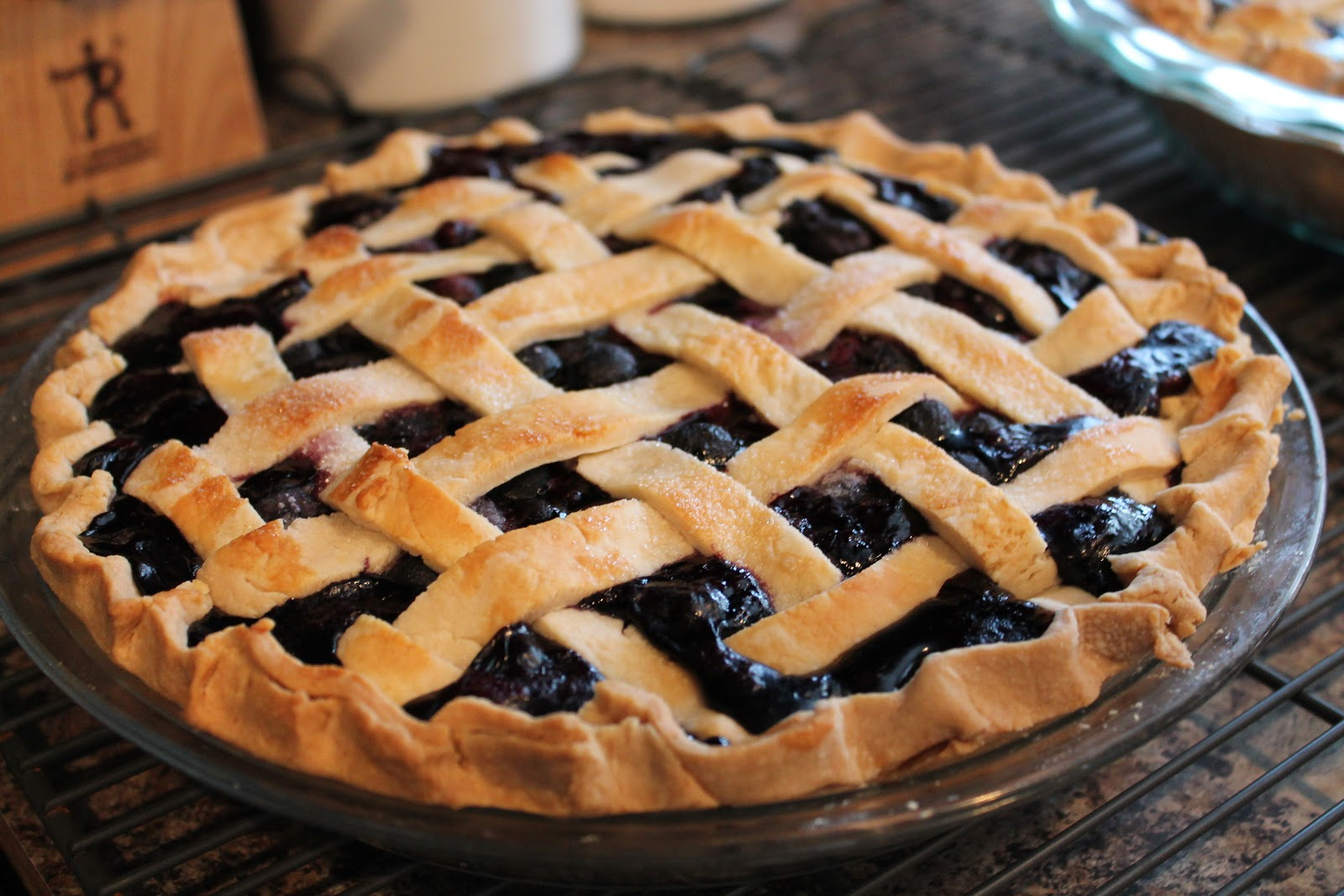 Visual of a blueberry pie celebrating National Blueberry Pie Day.
