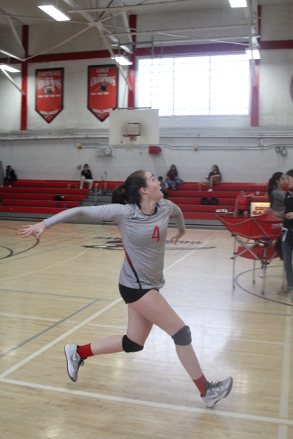 Senior Natalie Regaled playing volleyball, a fall sport.