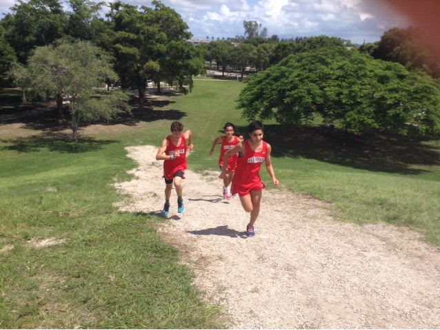 The boys' XC team practices running up the hill in preparation for the meet.