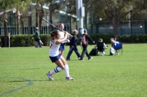Player for the Key Biscayne Field Hockey team, Valeria Gutierrez, in action during a game.