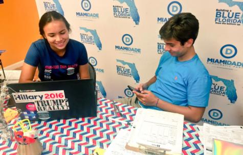 Nikita registering voters alongside sophomore Patrick Ales.