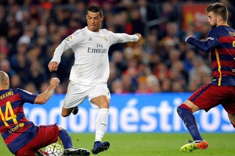 Mascherano and Pique attempt to stop Cristiano Ronaldo. He himself is trying to get rid of the ball