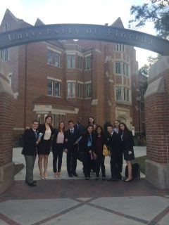 Gables' MUN team posing at the entrance of the University of Florida.