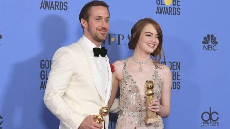 Ryan Gosling and Emma Stone pose together after winning Golden Globes for