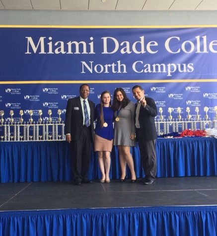 Junior Yanik Ariste receives an award for her demonstrated hard work in STEAM fields.
