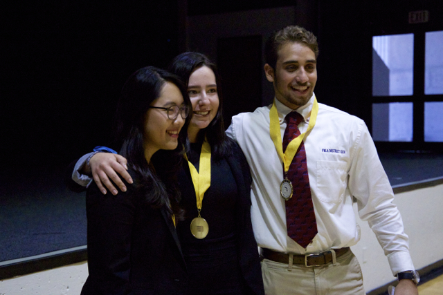 Marketing team receives first place medals (Maria Ordonez, Shawn Torres, Sunny Na).