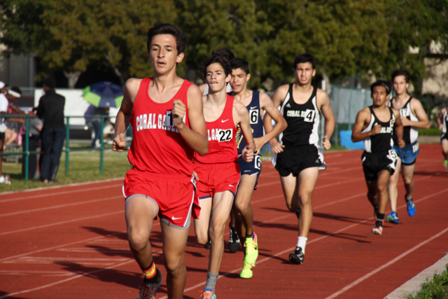 Sophomore+Anthony+Imperatori+and+junior+Mario+Garcia+participating+in+the+first+track+meet+of+the+year.