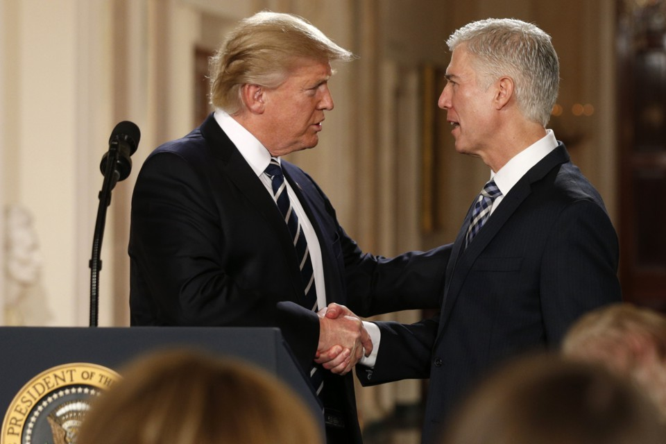 President Donald Trump shakes hand with Supreme Court nominee, Neil Gorsuch.