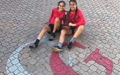 Flag Football Captain, Gabriela Morales, and teammate, Natalie Puntonet, together holding the award the team received for being the Districts Runner-ups.