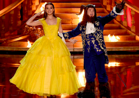 Adam DeVine and Hailee Steinfeld on stage as Belle and the Beast during the opening number.