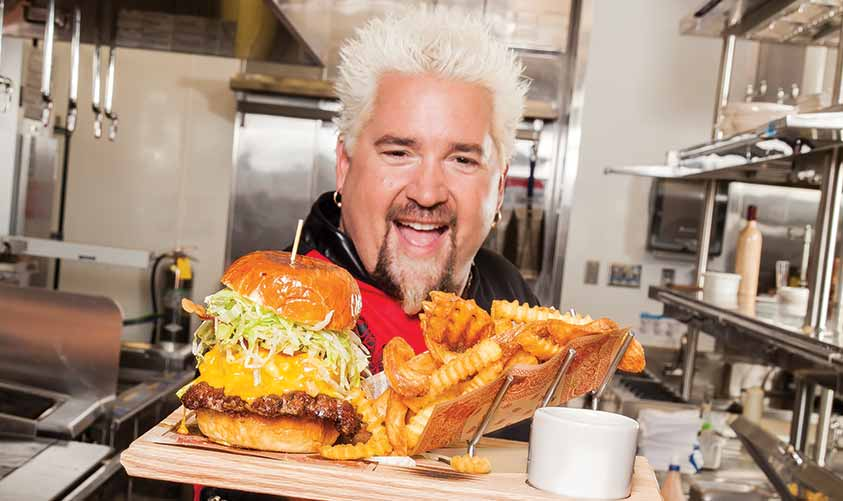 A+man+of+humble+beginnings%2C+Guy+Fieri+was+able+to+display+his+talent+to+the+world+after+winning+popular+challenge+the+%22Food+Network+Star%22+allowing+for+his+own+%22Guy%27s+Big+Bite%22+to+premiere+in+2006.