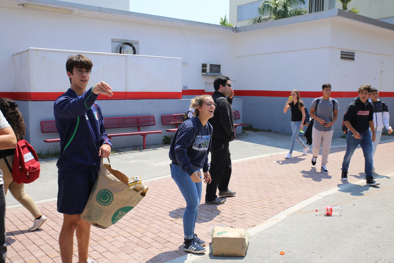 Seniors play a recycling game set up by Gables Earth.