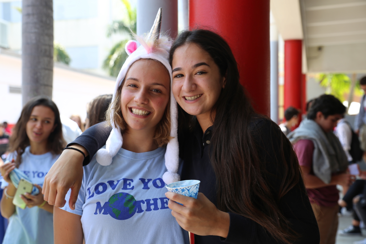 Senior and Gables Earth President Ximena Puig smiles for a picture with junior Isabella Morina.