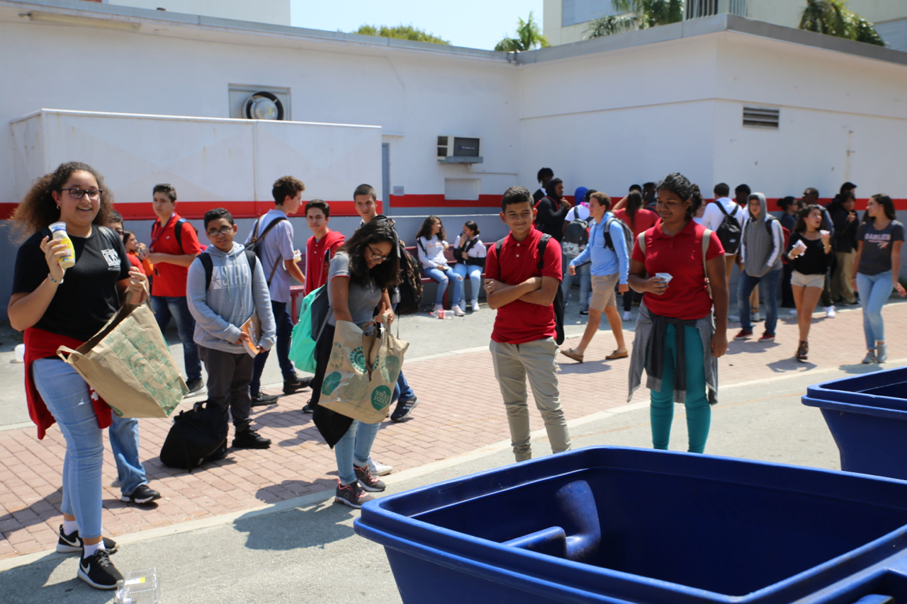 Students play a recycling game set up by Gables Earth.
