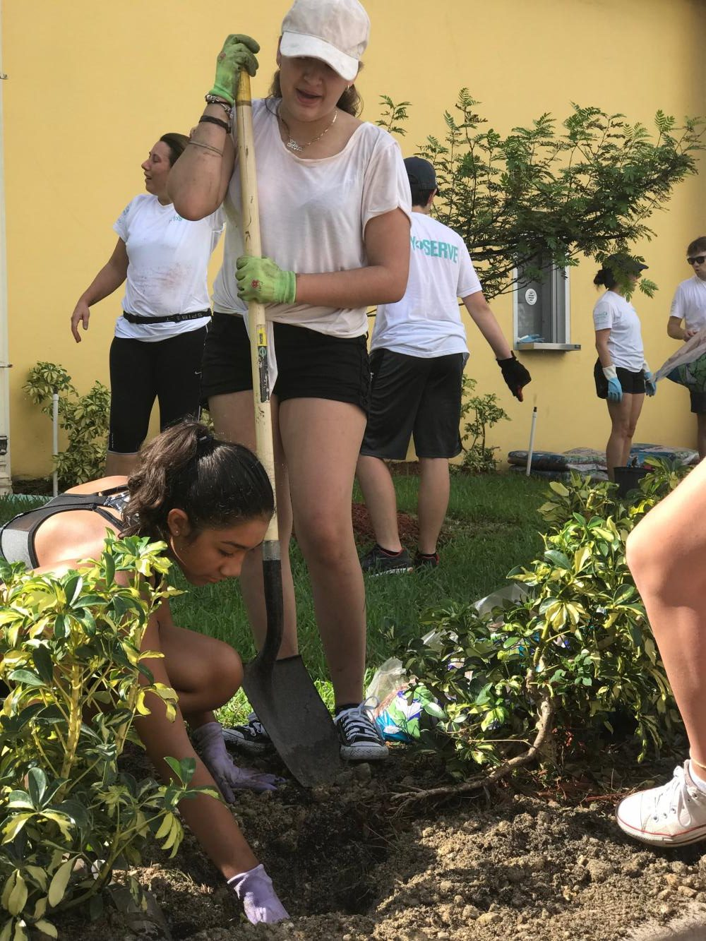 Students+get+their+hands+dirty+as+they+landscape+around+the+school.