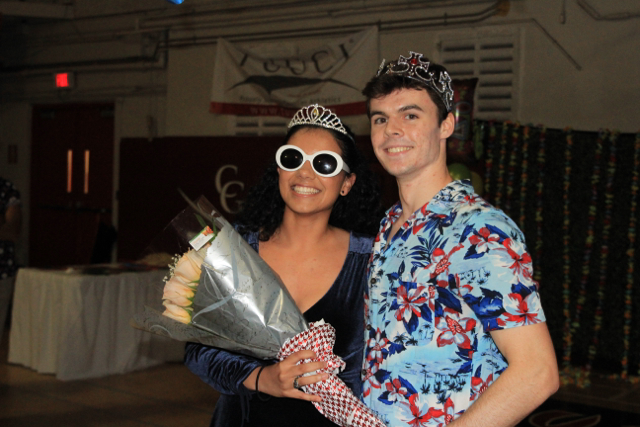 Luis and Henessy, Homecoming King and Queen pose for a photo.