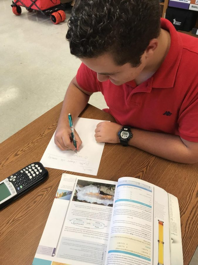 Alain Perez studies for a Chemistry quiz.