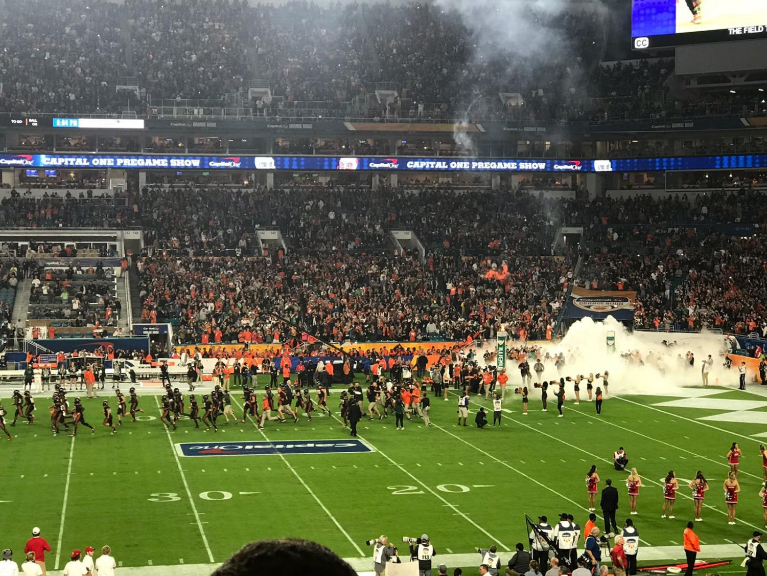 The Canes swarm the field for the start of the Capital One Orange Bowl at Hard Rock Stadium