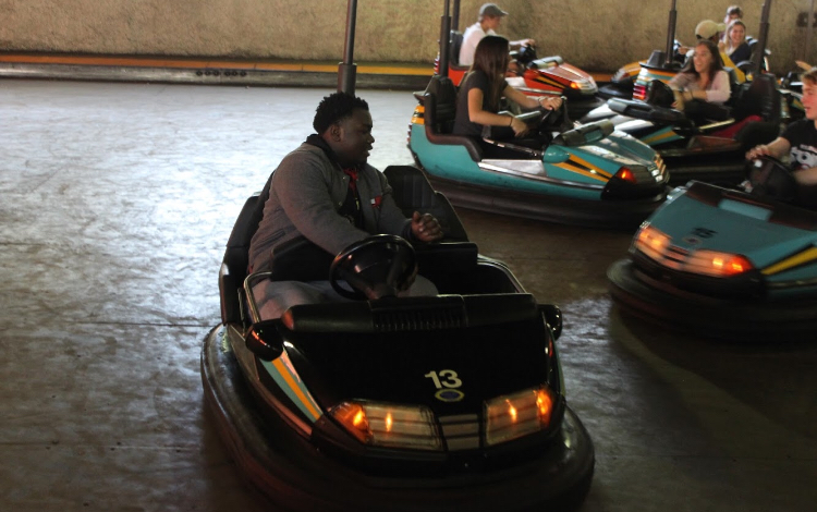 Students take a break from the thill of roller coasters and enjoy go-carting.