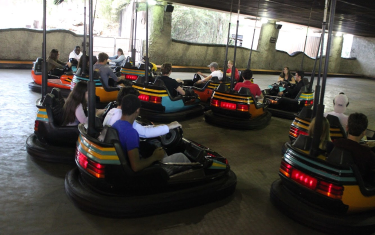 Students take a break from the rides and enjoy the go carts.