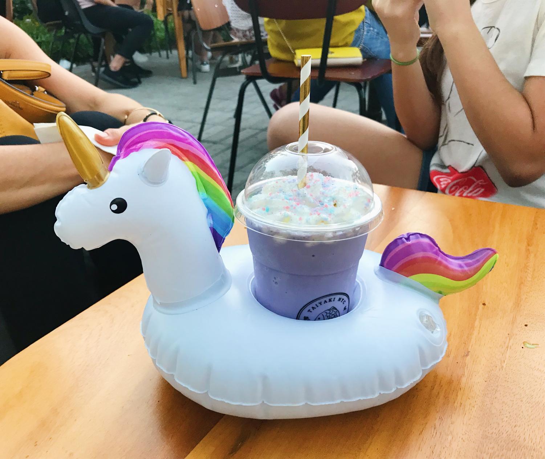 The+taro+slush+is+served+in+a+unicorn+floatie.