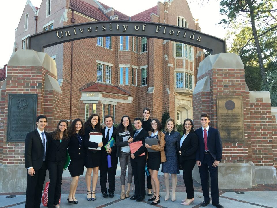 The Model UN team posing in front of one of the main entrances to the University of Florida before committee