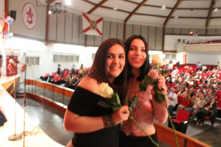 IB Juniors Eve Adan and Brianna Fernandez smile for a picture.
