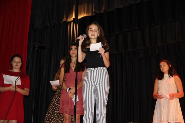 IB Sophmore Ana Capiro congratulates juniors in Spanish.