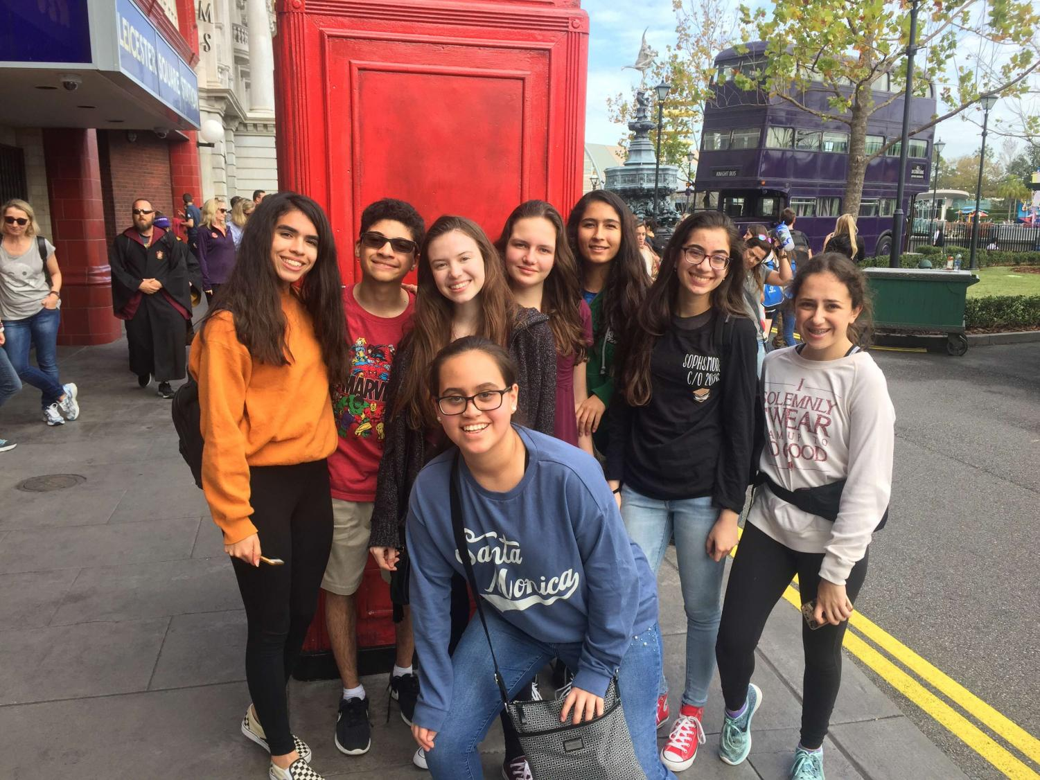 Sophomores+stand+in+front+of+Universal%27s+London+telephone+booth+replica+and+smile+for+a+picture.